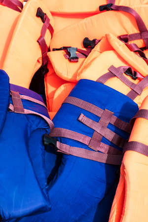 pile of life jackets as background