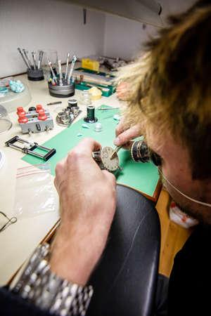 Watchmaker. Watch repair craftsman repairing watch. mans hands Stock fotó