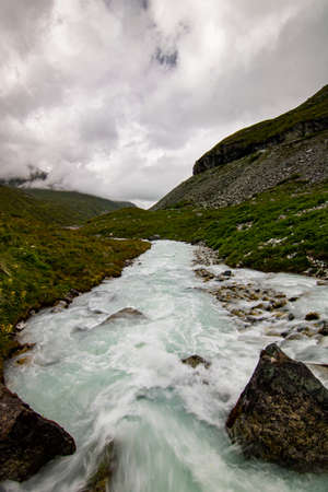clear water of a wild mountain stream in Switzerland, Lac de Moiry. water in motion
