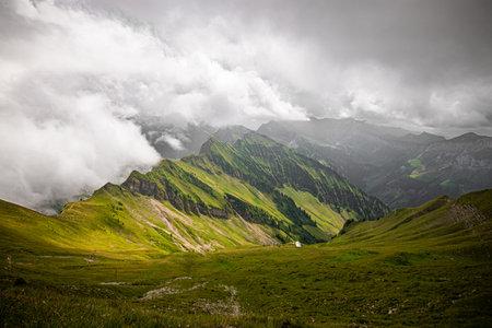 Alpine mountain Diethelm above the valley and alpine Lake Wagitalersee Waegitalersee , Innerthal - Canton of Schwyz, Switzerland. Travel photos