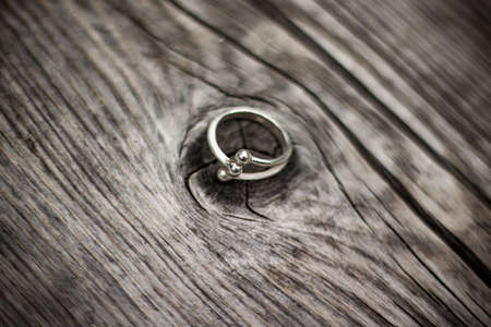 Jewelry ring with wood. Ring for weeding. wooden texture