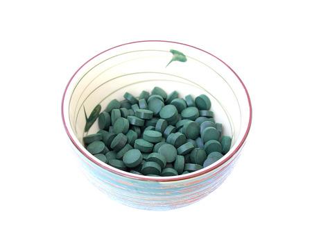 spirulina: spirulina in a bowl on a white background