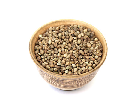 hemp hemp seed: hemp seed in a bowl on a white background