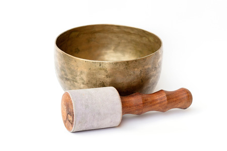 singing bowls: closeup of a tibetan bowl on a white background Stock Photo