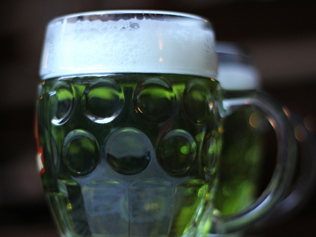 closeup of a glass jar with dyed green beer