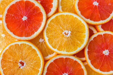 Abstract background with slices of yellow and red oranges