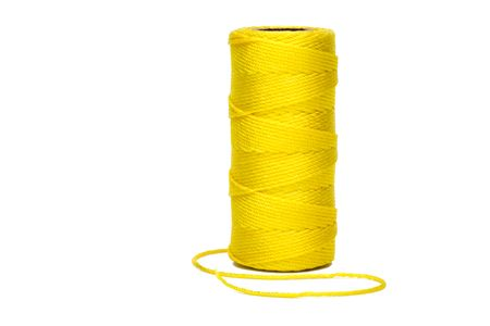 Yellow twine on spool standing on end.