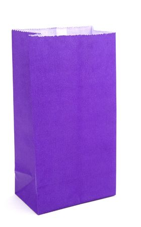 Purple paper bag isolated on white background for use in composites like school lunches gifts or anything where a colorful bag is needed.