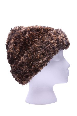 Fuzzy, warm kint cap on head isolated on white background. Stock Photo