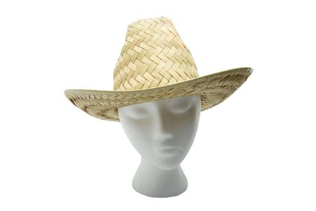 Woven straw farmers hat on a head, isolated on white background. Stock Photo