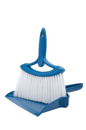 Blue dustpan and broom positioned for composite of persons hands holding while sweeping up. Stock Photo