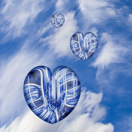 Three hearts in the sky against white clouds.  Could portray travel, , love or things of a spiritual nature. Stock Photo