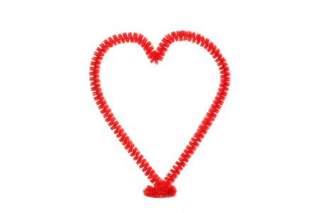 Hand-made red chenille heart isolated on white background for use alone or in composites.