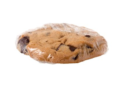 Chunky chocolate chip cookie, wrapped in plastic to preserve freshness.