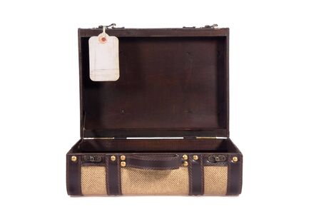 Vintage suitcase made from wood, canvas and leather, open with tag for message. Stock Photo
