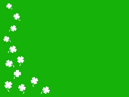 Small white shamrocks on green background Stock Photo - 798587