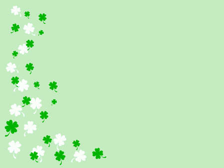 Small green and white shamrocks on light green background Stock Photo