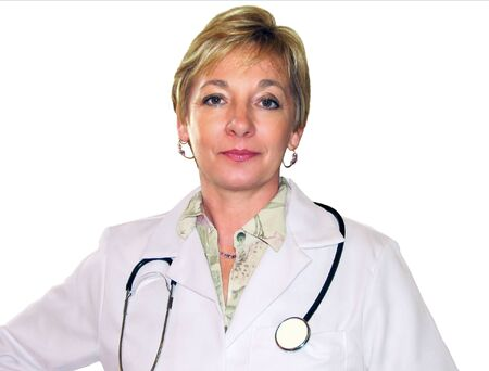 Attractive mature woman medical practitioner wearing white coat and stethoscope.