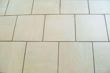Square ceramic tile floor.