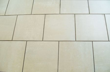 Square ceramic tile floor.