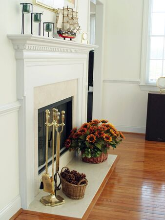 Marble fireplace with andirons and cheerful decorations.