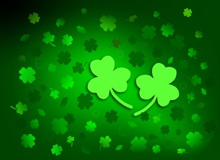 Scattered shamrocks on gradient green background. Stock Photo