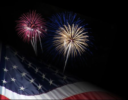 USA flag with fireworks display bursting in air on black background