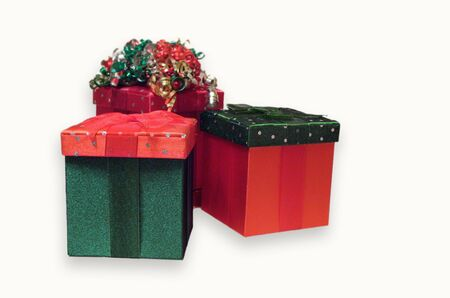 Three holiday gift boxes in red and green velvet with bows isolated on white  Stok Fotoğraf
