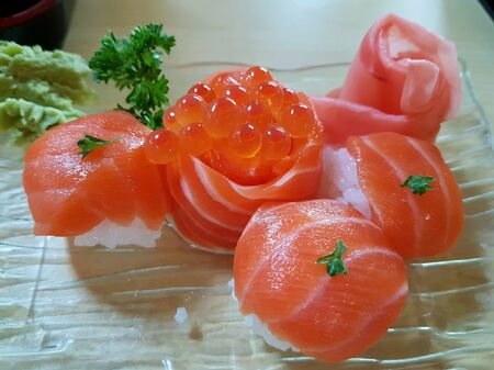 fresh salmon sushi with ikura caviar served on plate with wasabi Stock Photo