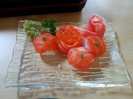 Isolated image of healthy Japanese fresh salmon fish with ikura caviar served on plate