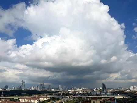 Big huge clouds forming over Johor Bahru cityscape as storm is approaching in the afternoon.