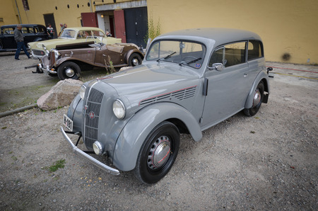 Skien, Norway, Sep 16 2012: Front left side of grey Opel veteran vintage car at the Grenland car club.