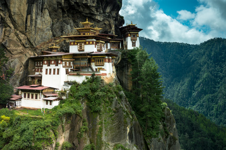 PARO, BHUTAN - AUGUST 11, 2014: Paro Taktsang Monastery is the most famous buddhist temple complex of Bhutan which clings to a cliff, 3120 meters above the sea level on the upper side of Paro valley, Bhutan.