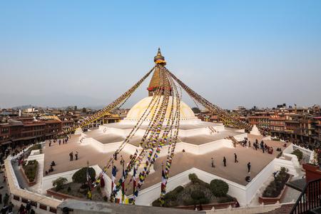 stupa one: KATHMANDU, NEPAL - FEBRUARY 16, 2015: Tourists and Nepalese people gather around Boudhanath on February 16, 2015 in Kathmandu, Nepal.Boudhanath is one of the largest ancient buddhist stupa in the world. Editorial