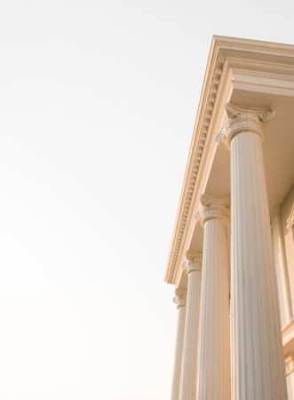 doric: Doric columns on white sky background.