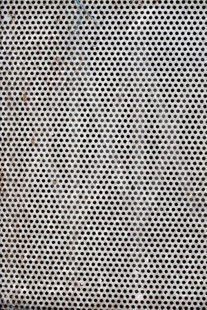 perforated metal: Old rusted perforated metal sheet background texture. Stock Photo