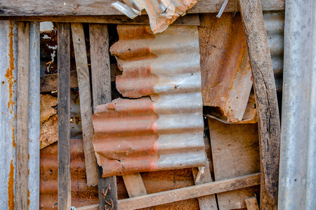 corrugated steel: Old and rusty damaged galvanized iron plate.