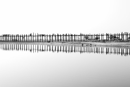 teakwood: Black and white of U Bein bridge which is the oldest and longest teakwood bridge in the world at Taung Tha Man Lake in Amarapura, Mandalay, Myanmar.