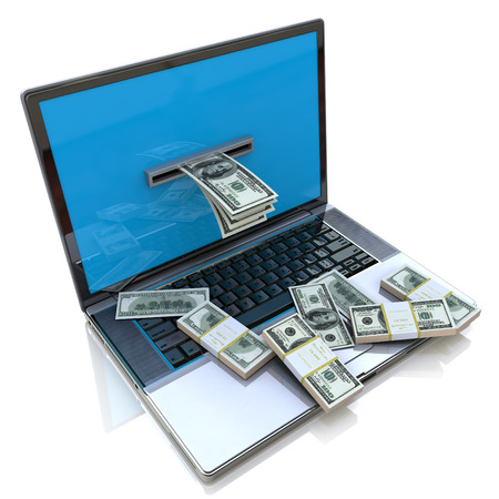 make: making money online - withdrawing dollars from laptop, Earnings on the Internet Stock Photo