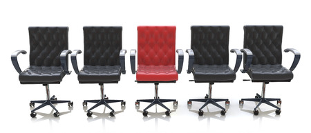 disharmony: red office chair among black chairs isolated on white background