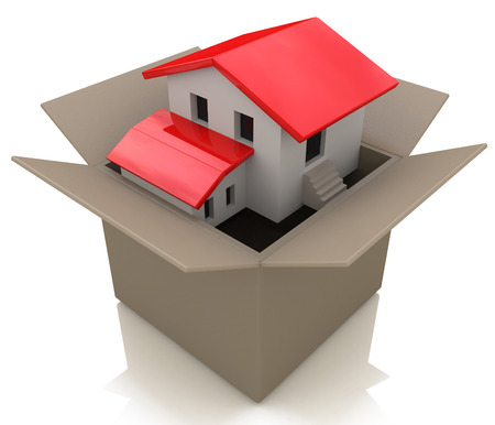 Moving house and move day with a model home in an opened cardboard box as an illustration of the healthy real estate market sales and packing to change neighborhood due to business work transfer Imagens