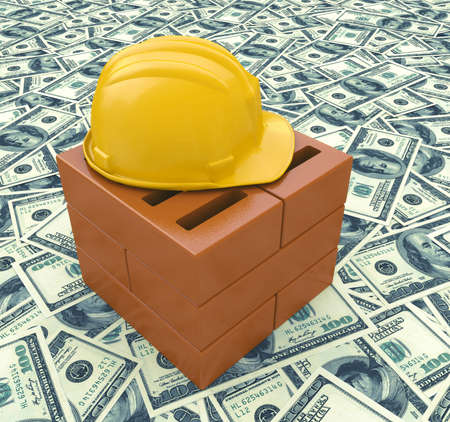 economic activity: Construction business with a yellow hardhat helmet on a floor of money and currency representing the economic condition of commercial and residential building activity and investment Stock Photo