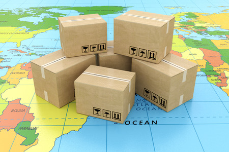 Global logistics, shipping and worldwide delivery business concept: heap of stacked corrugated cardboard boxes with parcel goods on the world map