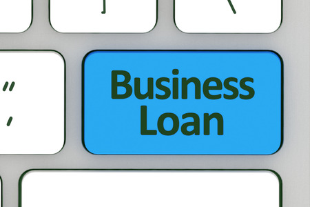 loans: Computer notebook keyboard with Hot key for business loans - technology background