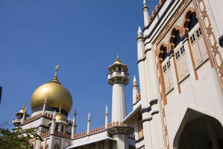 Mosque with Minaret against blue sky photo