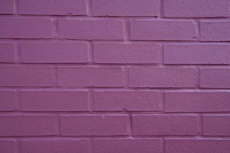 Photograph of a brick wall painted purple. Great for copy space photo