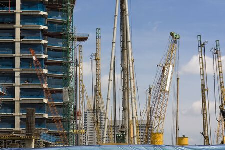 erect: Construction site with many cranes Stock Photo