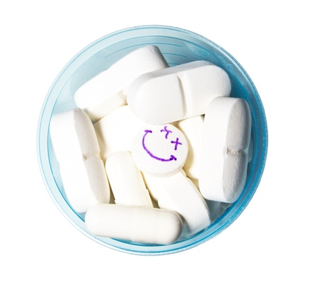 smiley face pill in a cup