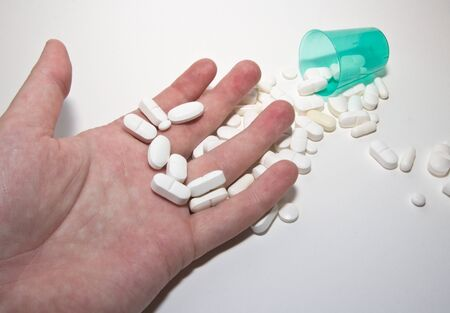 white pills and hand Stock Photo