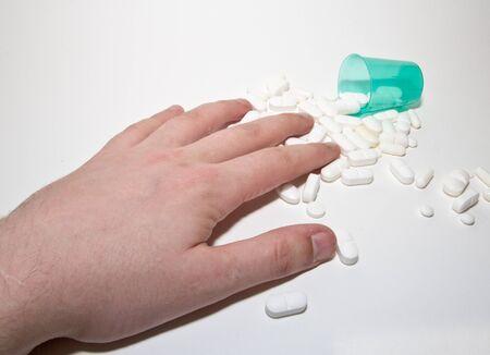 white pills and hand Stock Photo
